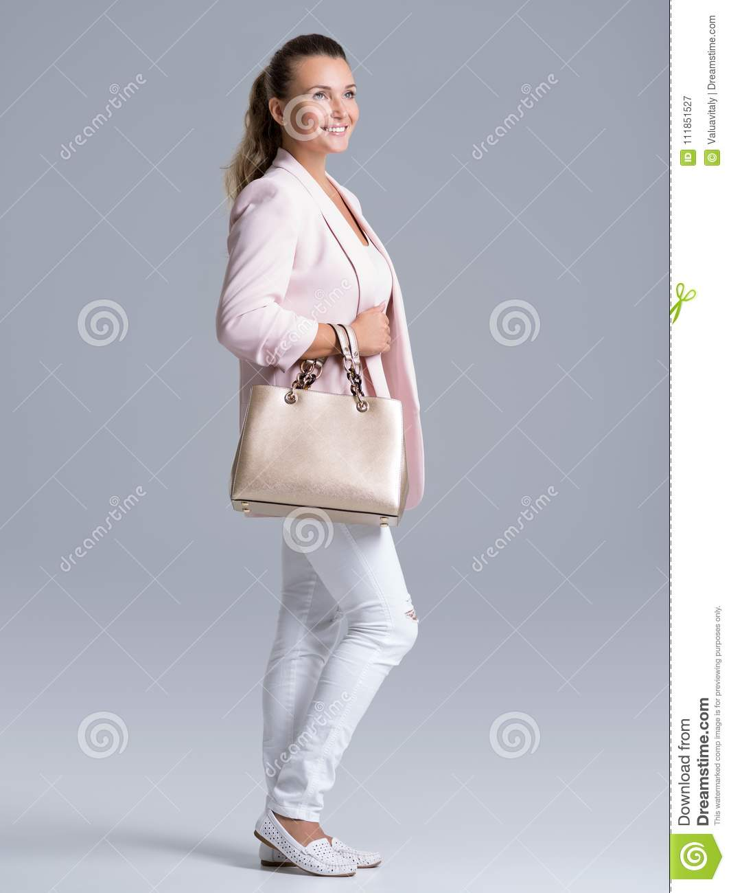 Portrait of an young happy woman with handbag