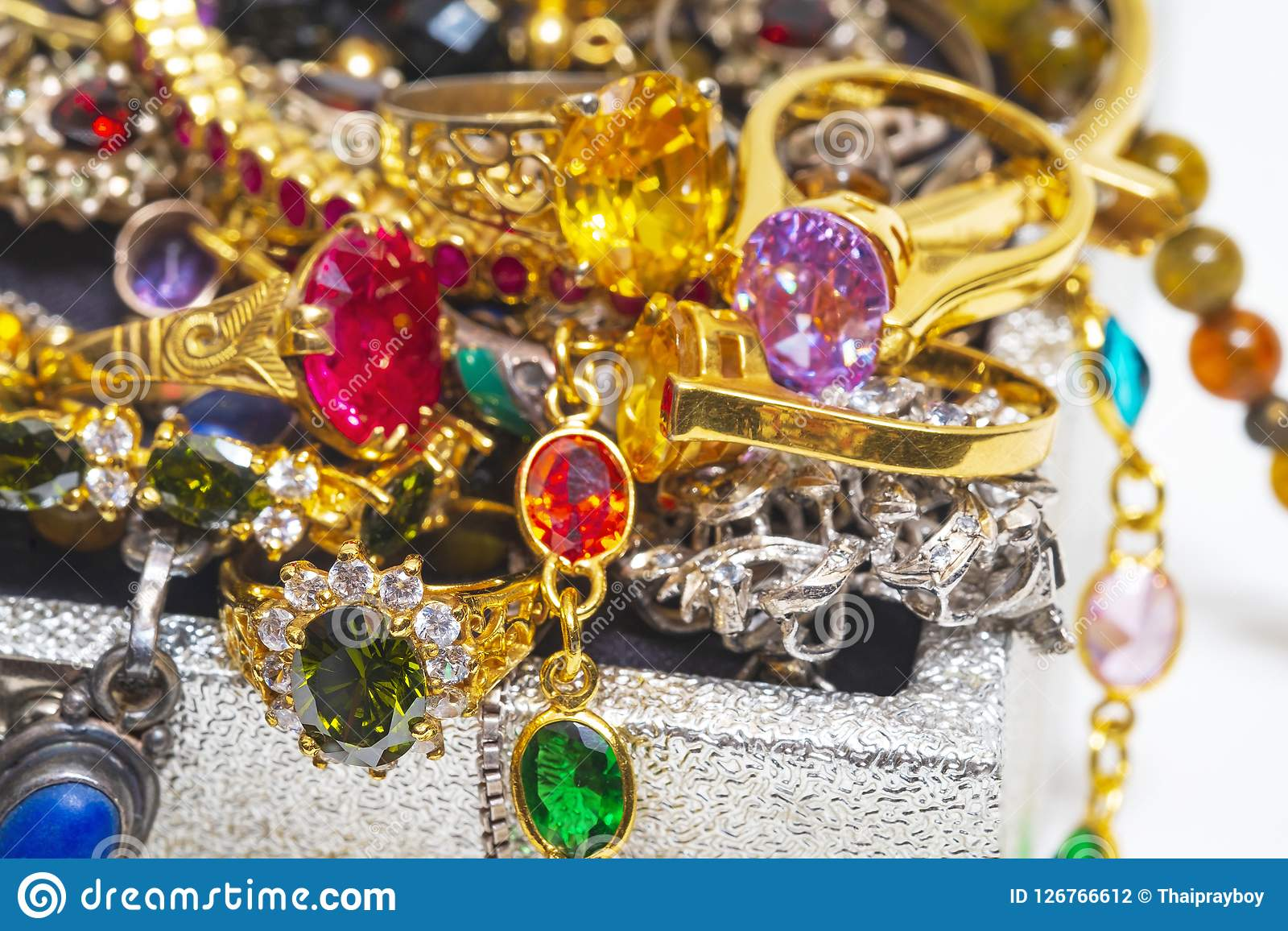 Full of Precious Gems and Jewelly, Rings in the Treasure Chest o. N White Background Stock Photography