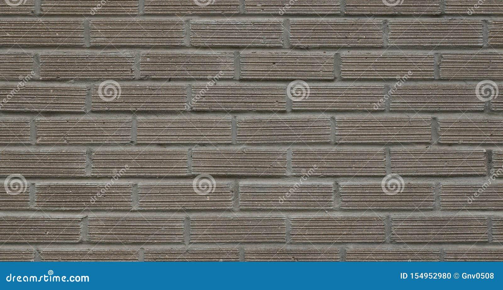 Full rambild av den gråa dekorativa tegelstenväggen, byggnadsyttersida S?ml?s textur f?r h?g uppl?sning