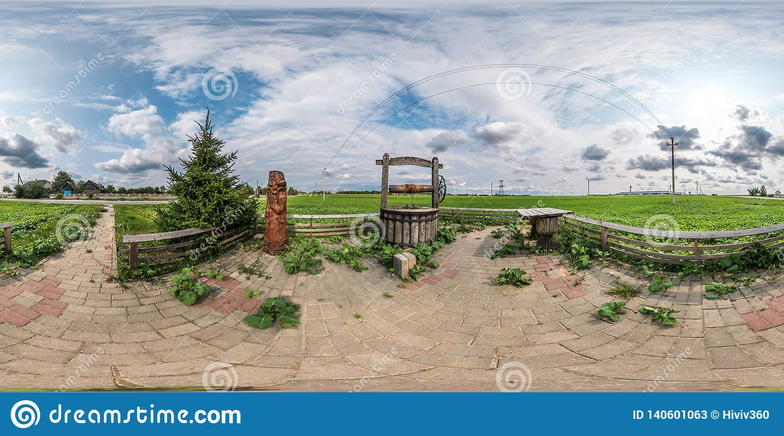 Full seamless spherical panorama 360 by 180 angle view a place of rest with a well sump and wooden table in equirectangular