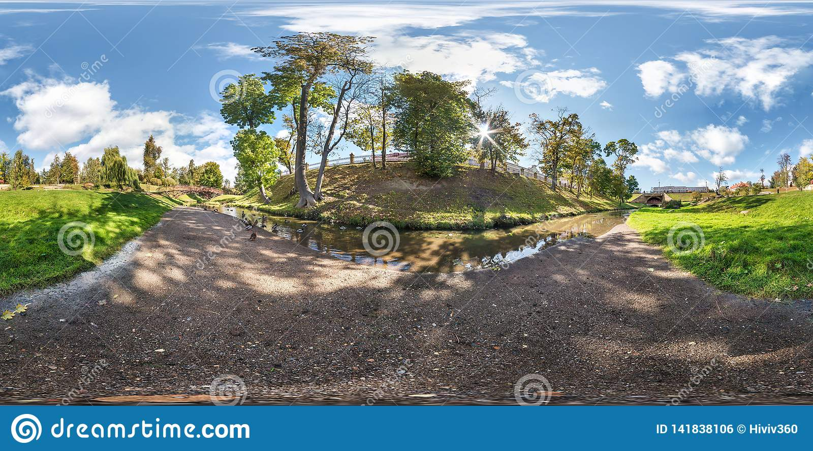 Full seamless spherical panorama 360 by 180 degrees angle view on the shore of small river with ducks in city park in summer day
