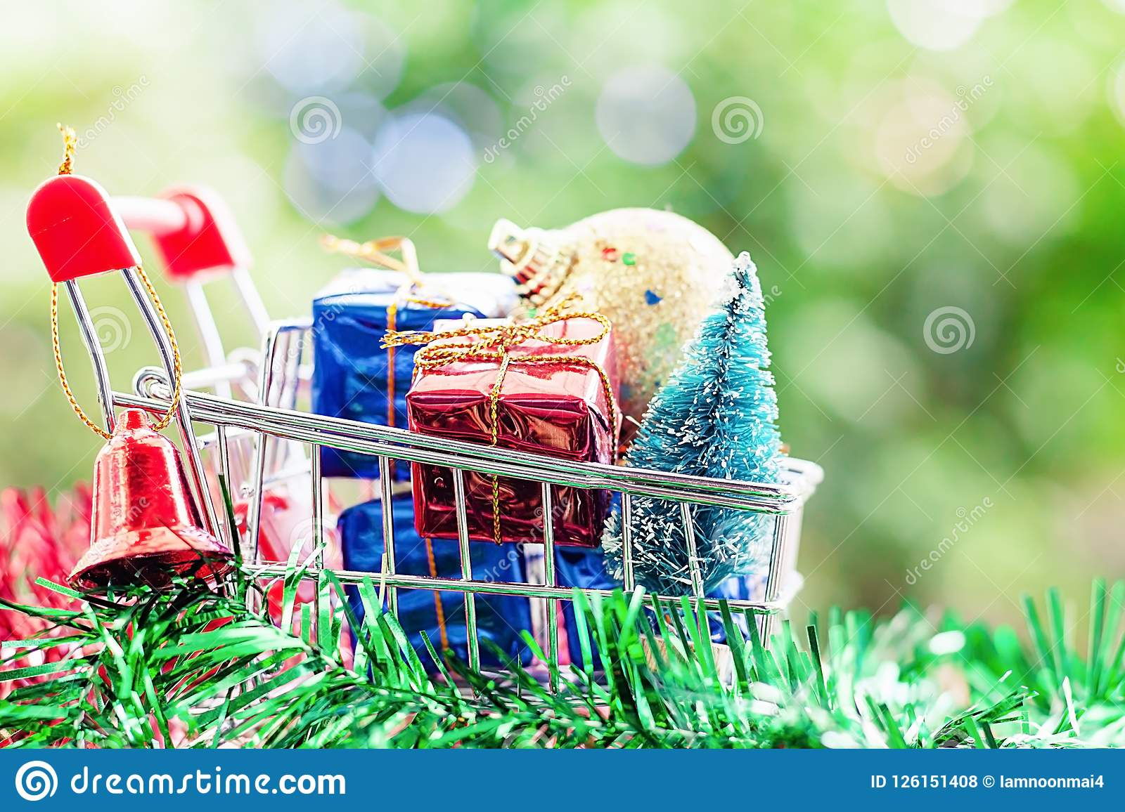 Full of Xmas decorative items in mini shopping cart or trolley a