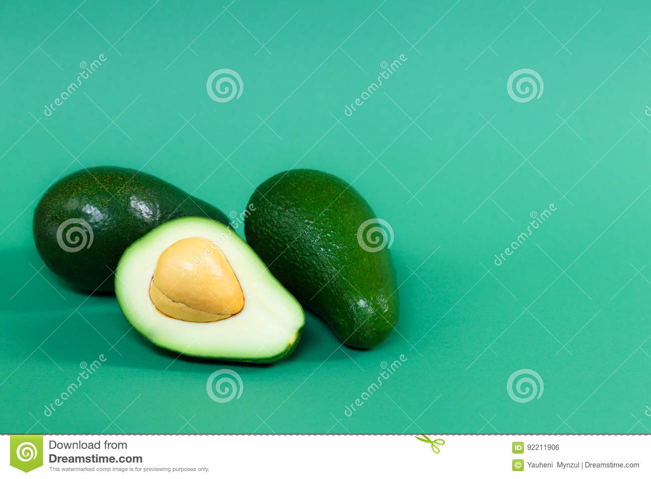 Fully ripened avocado on a green background