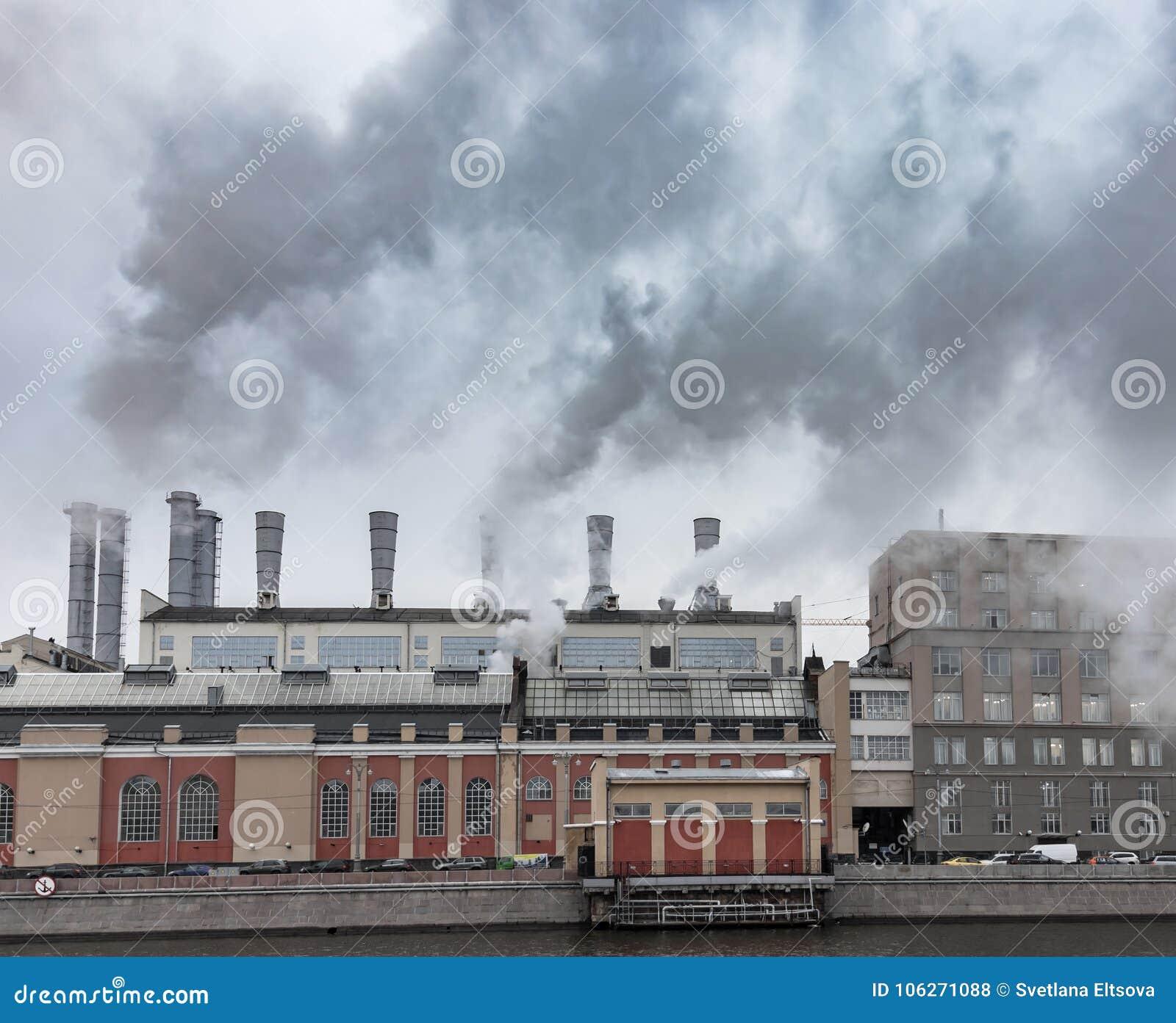 Fuming smokestacks of a factory. Environmental pollution
