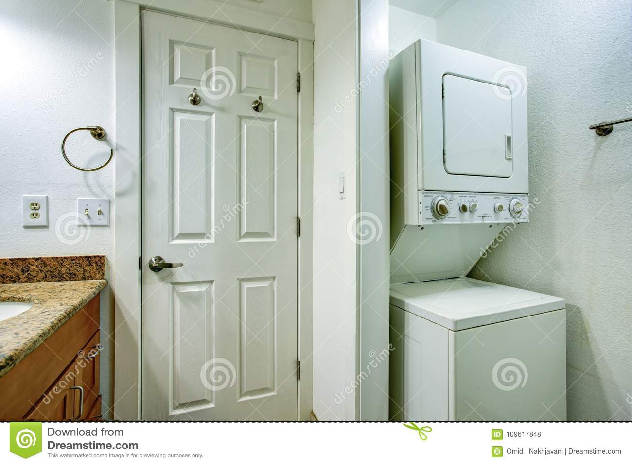 Fun Bathroom With Bathroom Vanity And Stacked Washer And