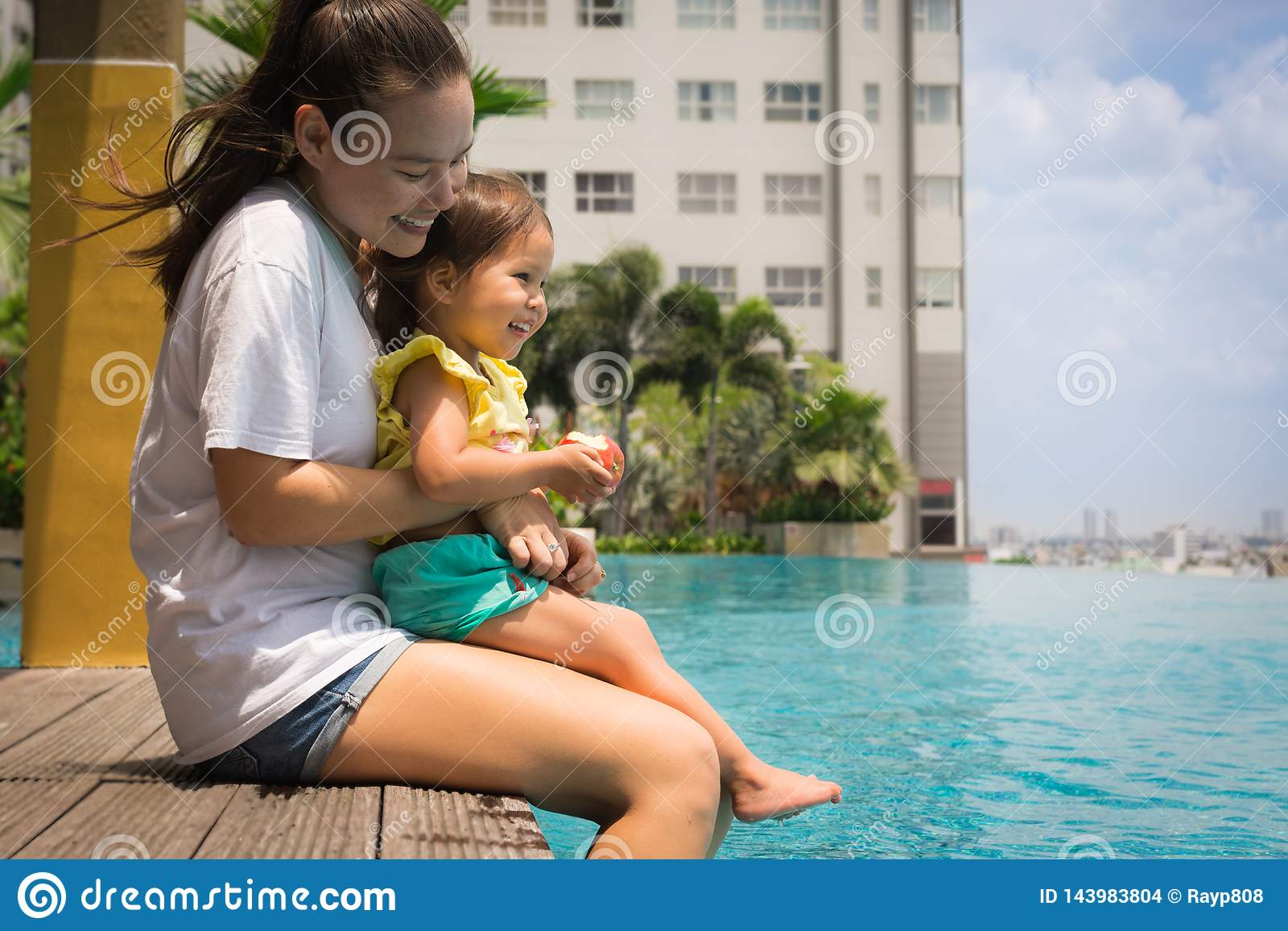 Fun family pool time with mother and child. Vacation time
