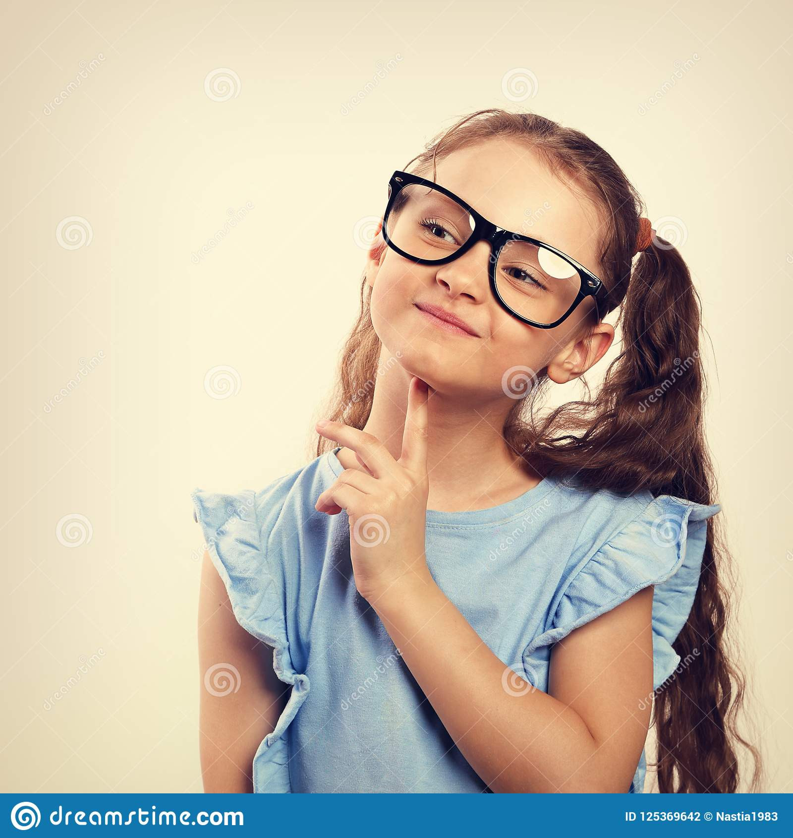 96e0e88b67 Fun Grimacing Happy Girl In Eye Glasses Thinking And Looking Up ...