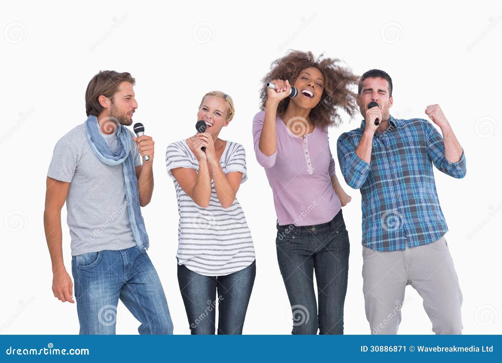 Fun Group Singing At Karaoke Stock Image - Image of posing ... Group Singing Images