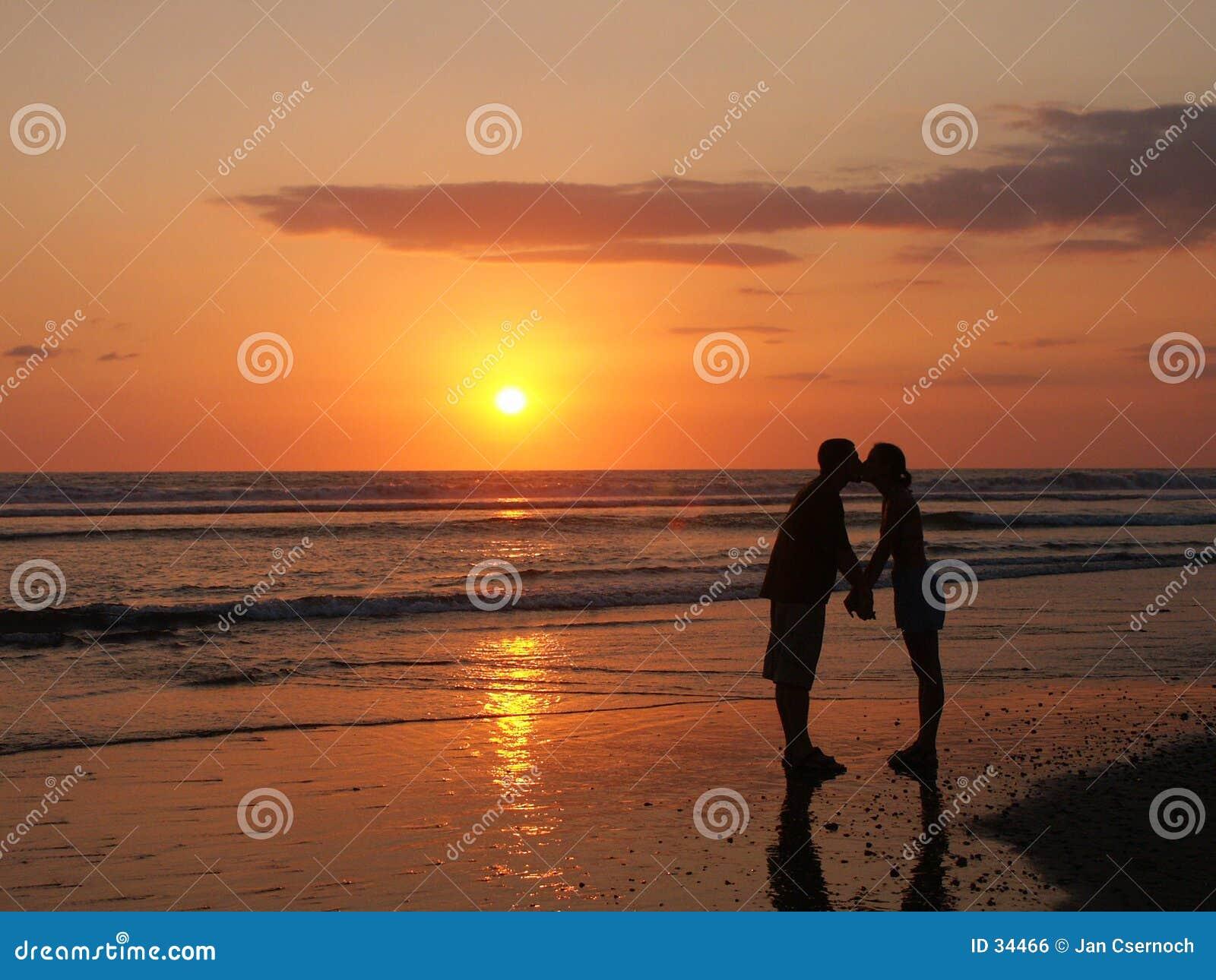 Fun kiss on the beach