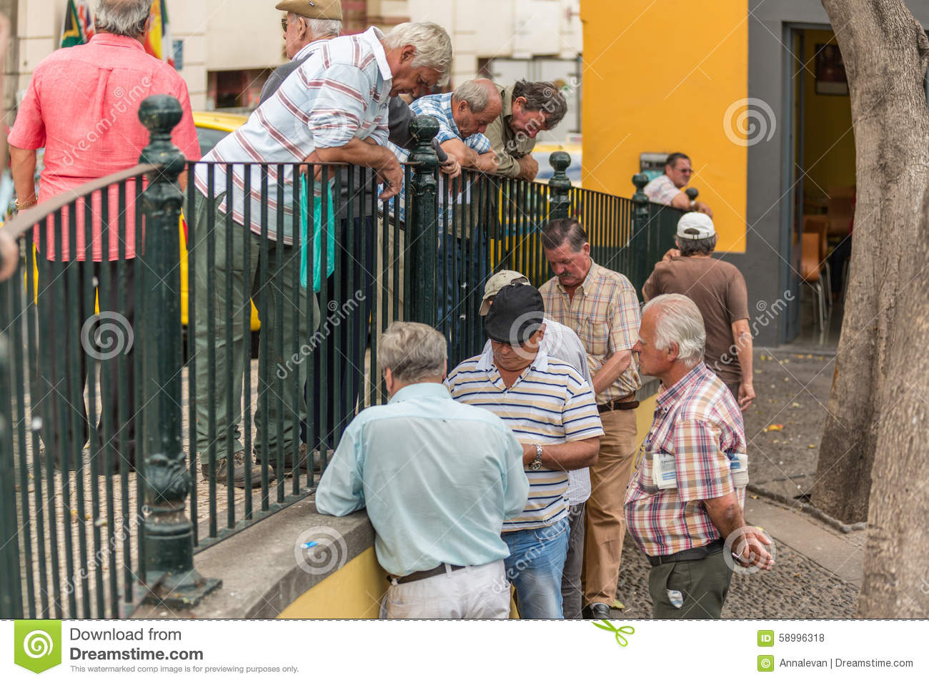 FUNCHAL, PORTUGAL - JUNE 27, 2015: Active retirement, old people and seniors free time, elderly men having fun and playing cards