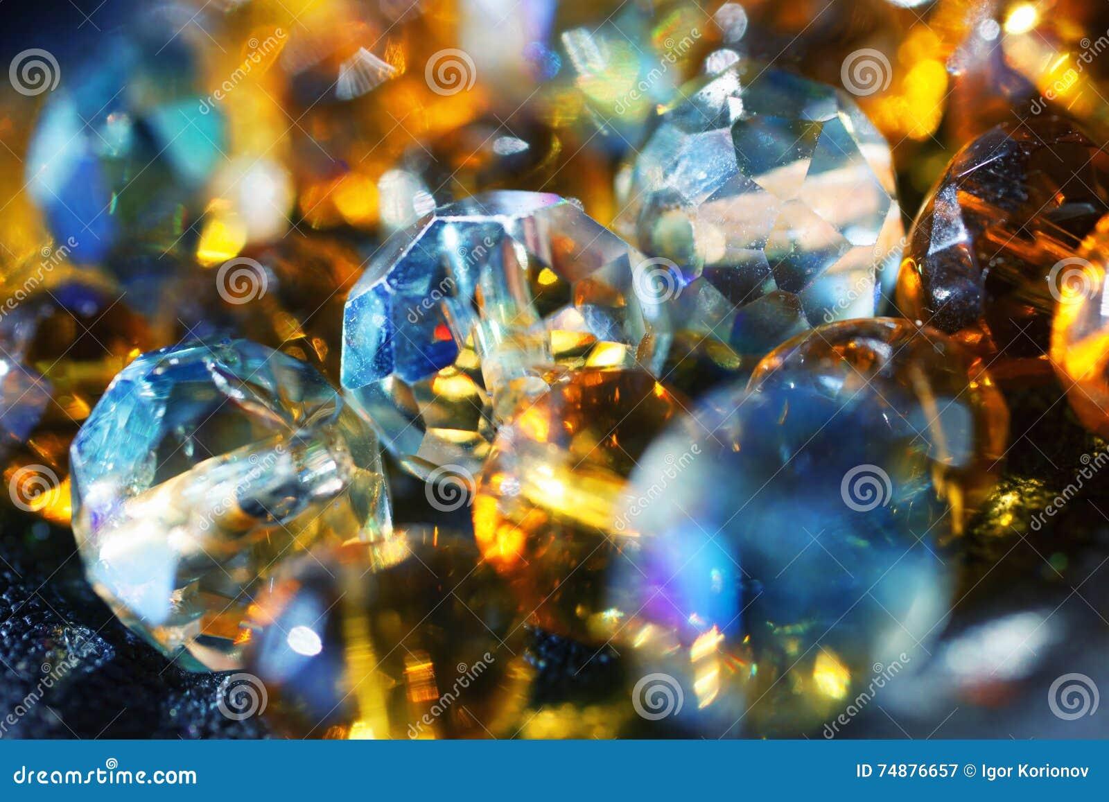 Fundo abstrato com os grânulos de vidro brilhantes