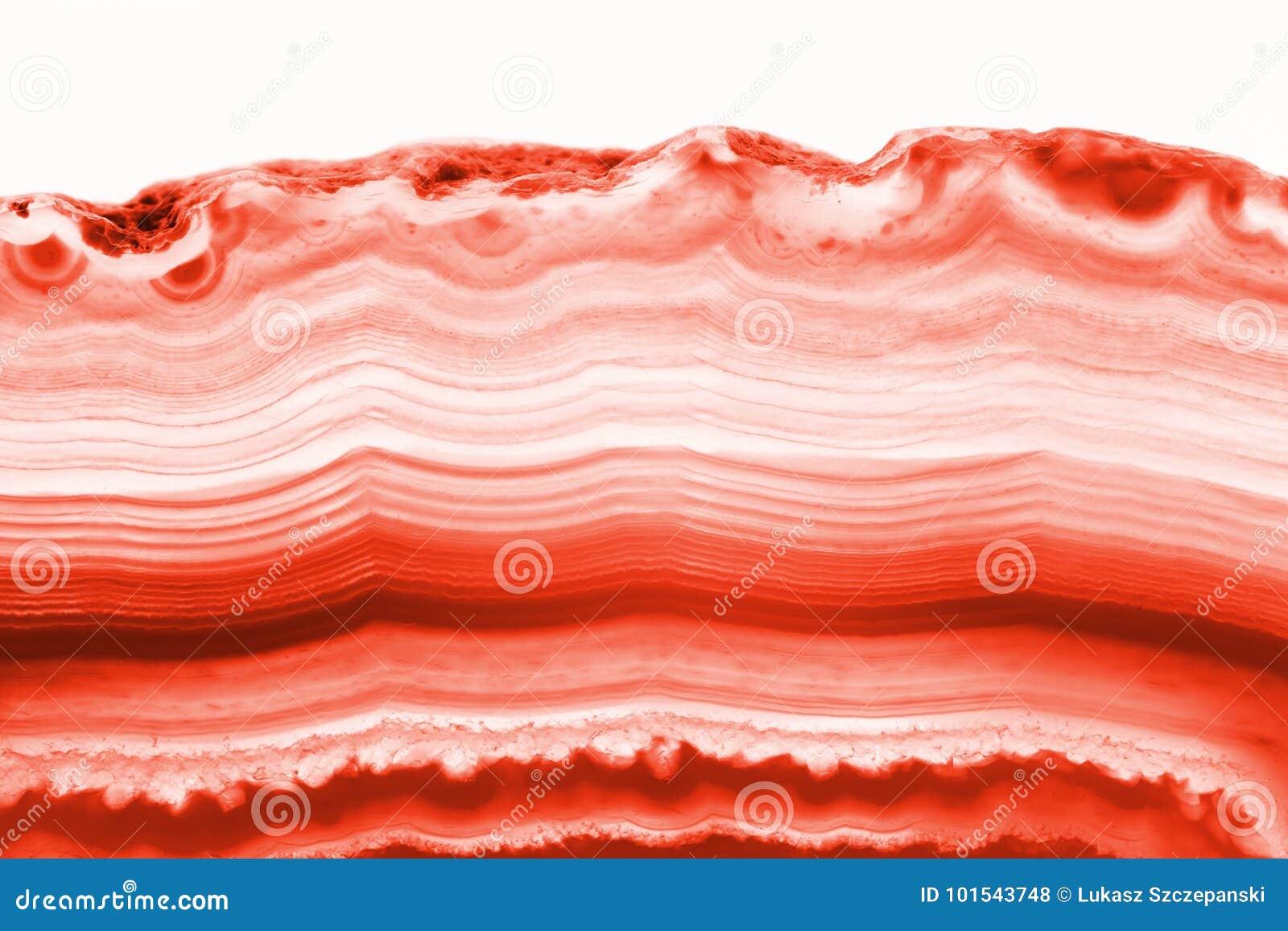 Fundo abstrato - mineral de seção transversal da fatia da ágata vermelha