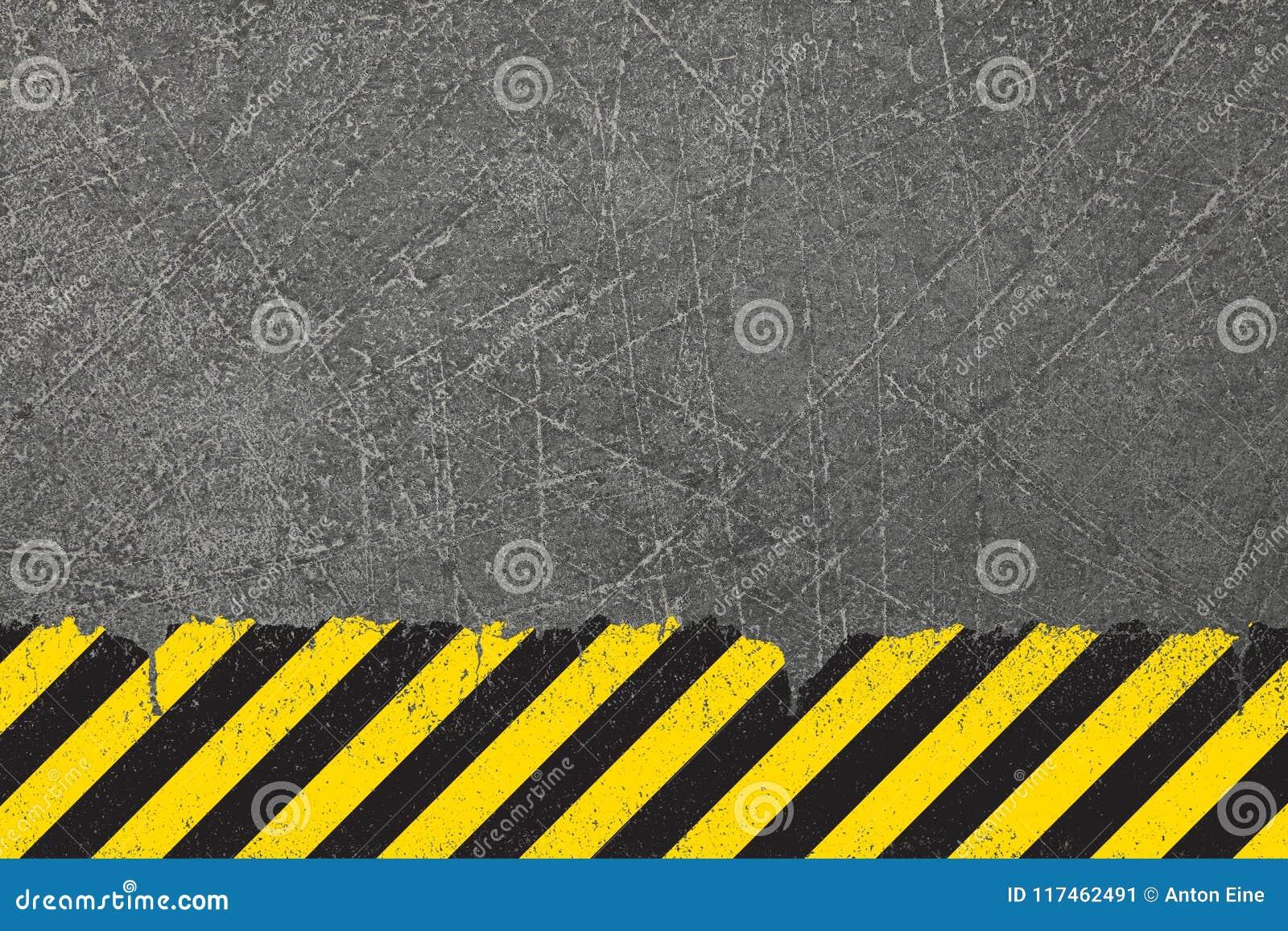 Fundo amarelo com sinal de perigo preto do grunge