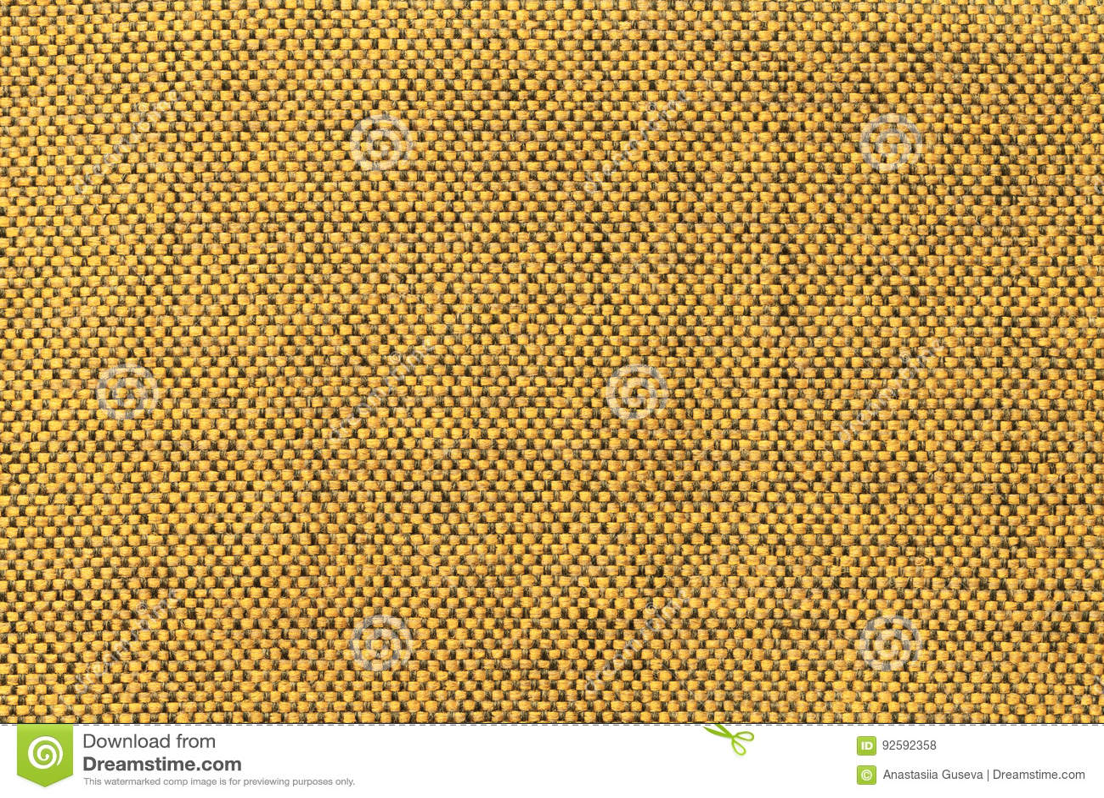Fundo amarelo escuro de matéria têxtil com teste padrão da xadrez, close up Estrutura do macro da tela