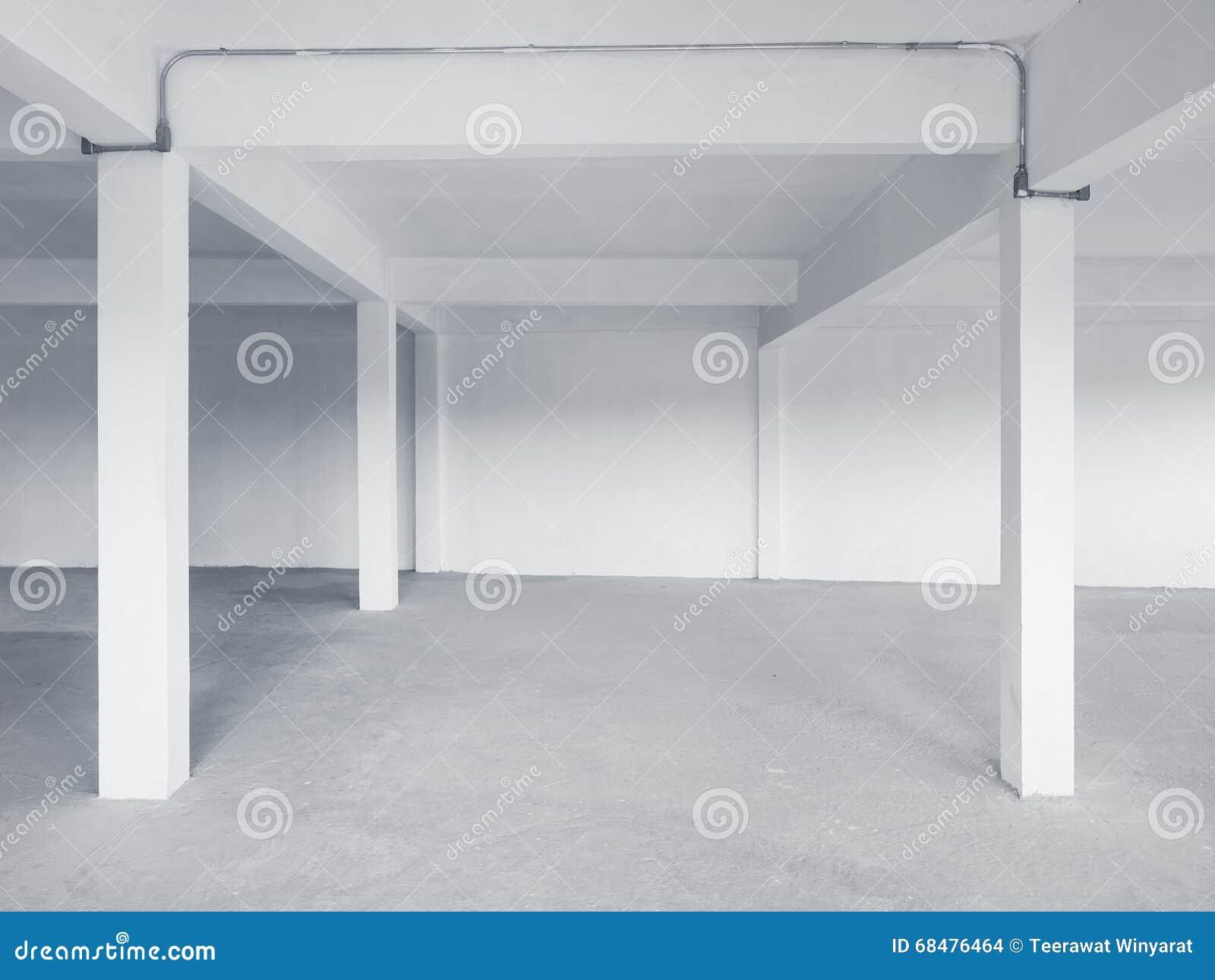 Fundo branco do interior do assoalho do cimento da parede do espaço vazio