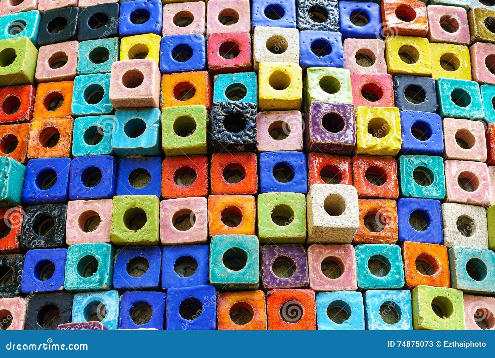 Fundo cerâmico colorido da textura do cubo