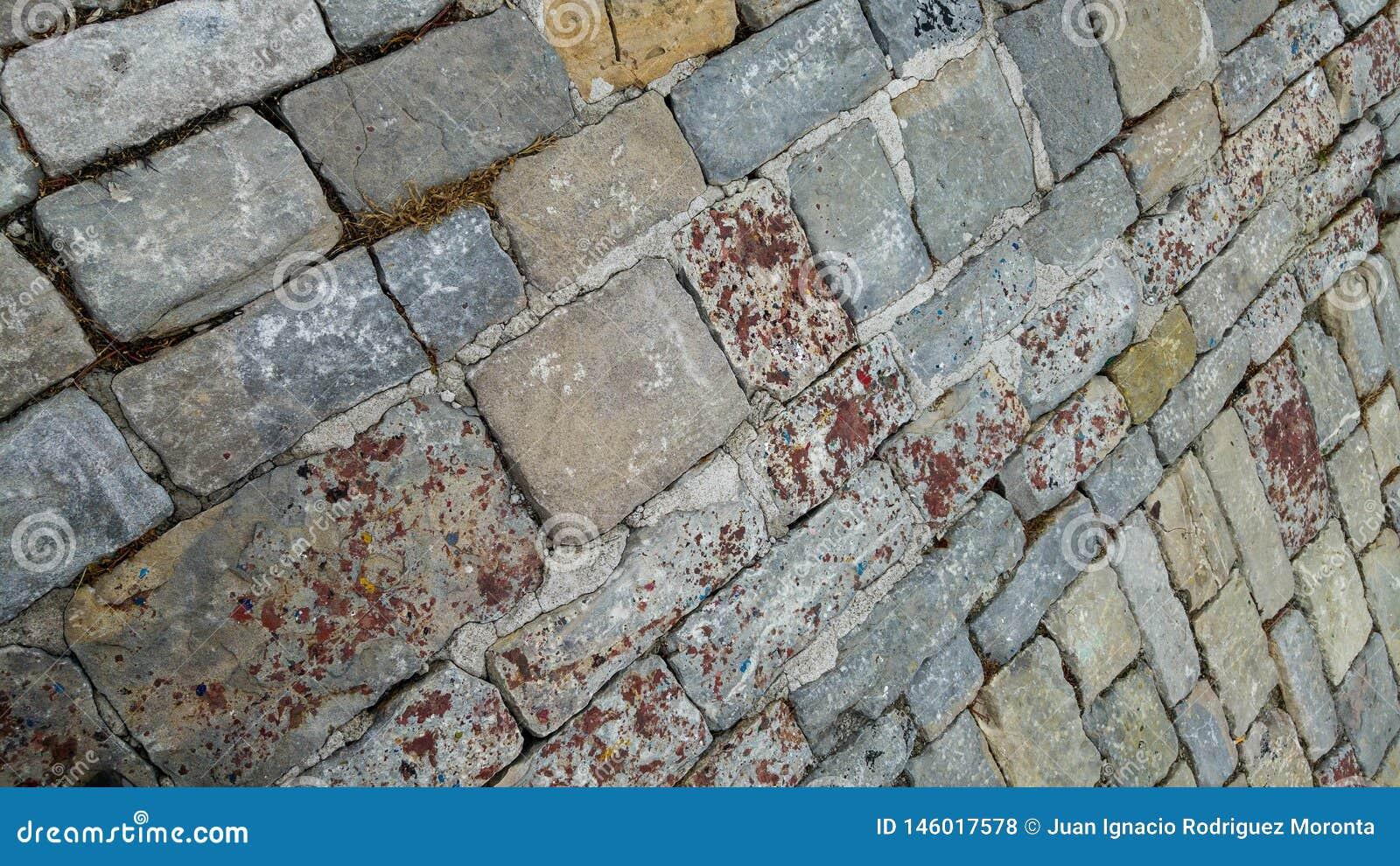 Fundo cobblestoned do pavimento do granito Textura de pedra do pavimento