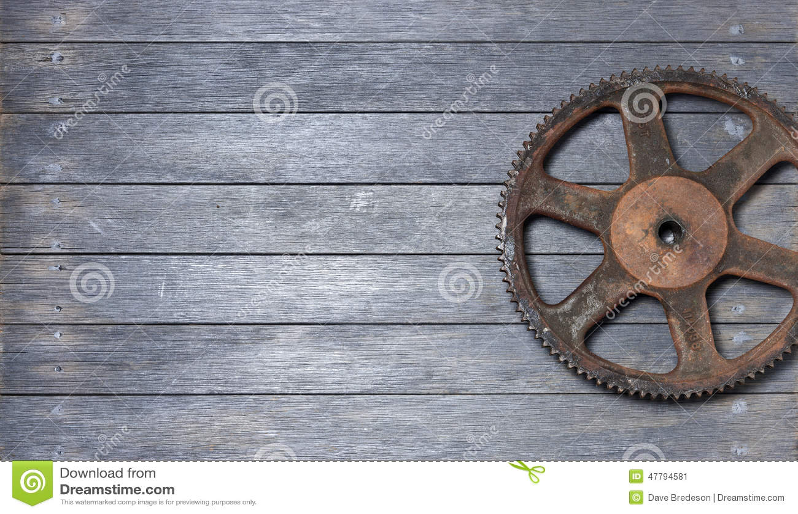 Fundo da madeira da roda denteada