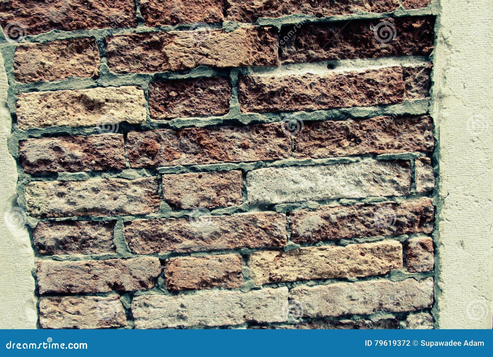 Fundo da parede de tijolo velha do vintage