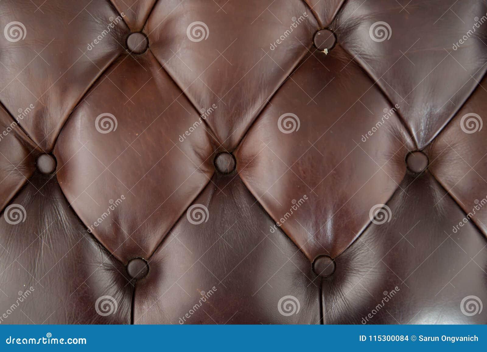 Fundo da textura do sofá do couro de Brown