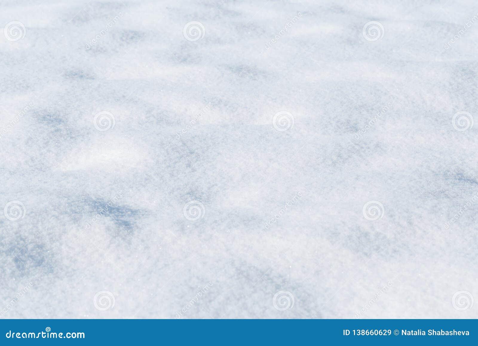 Fundo da textura fresca da neve no tom azul