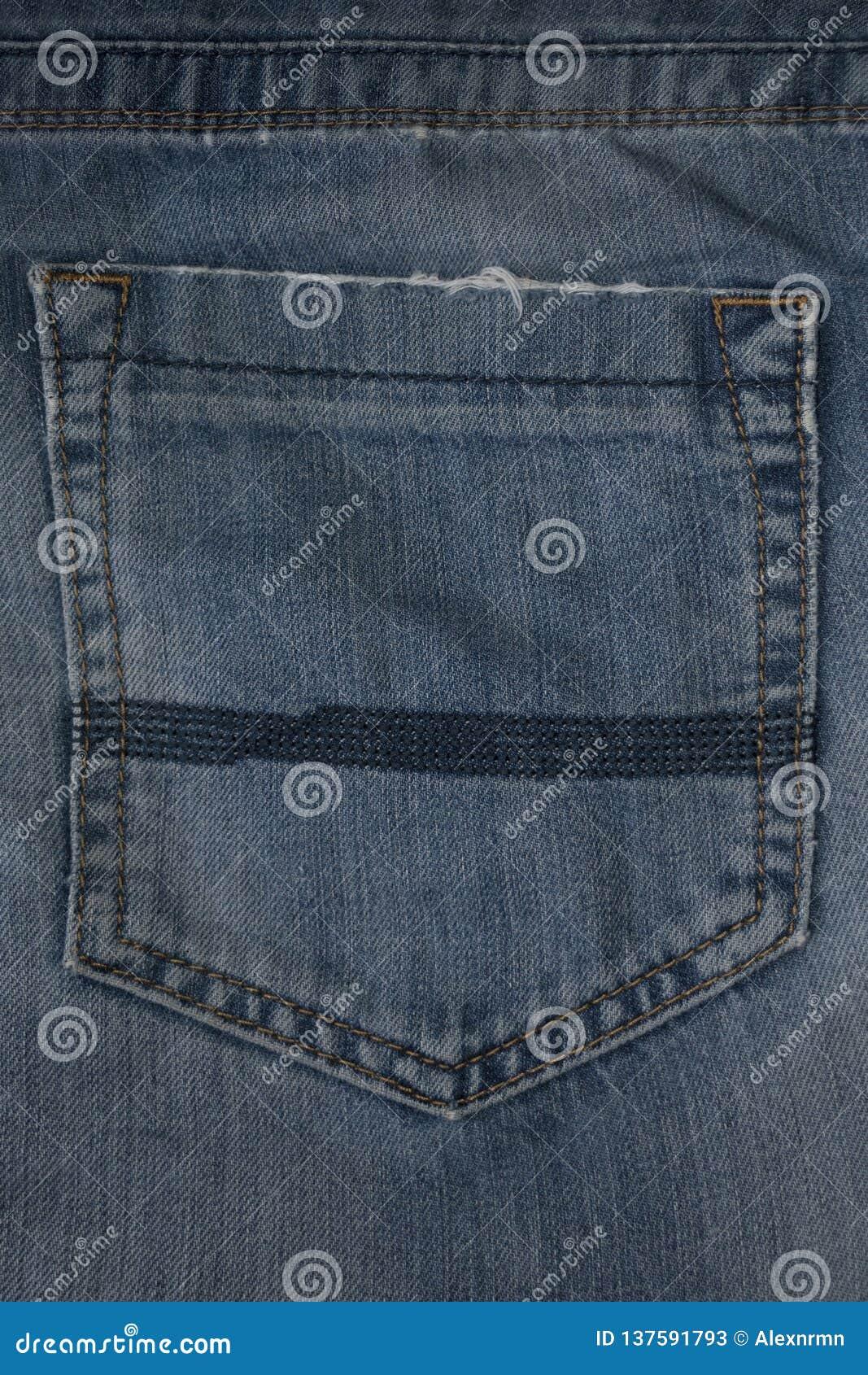 Fundo da textura da sarja de Nimes, calças de brim gastas e bolso da sarja de Nimes