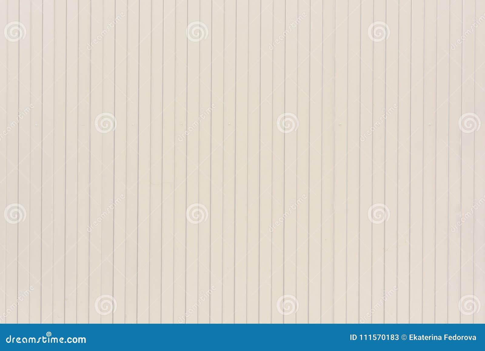 Fundo de linhas verticais de linhas Empalideça a parede bege de listras incomuns, laths