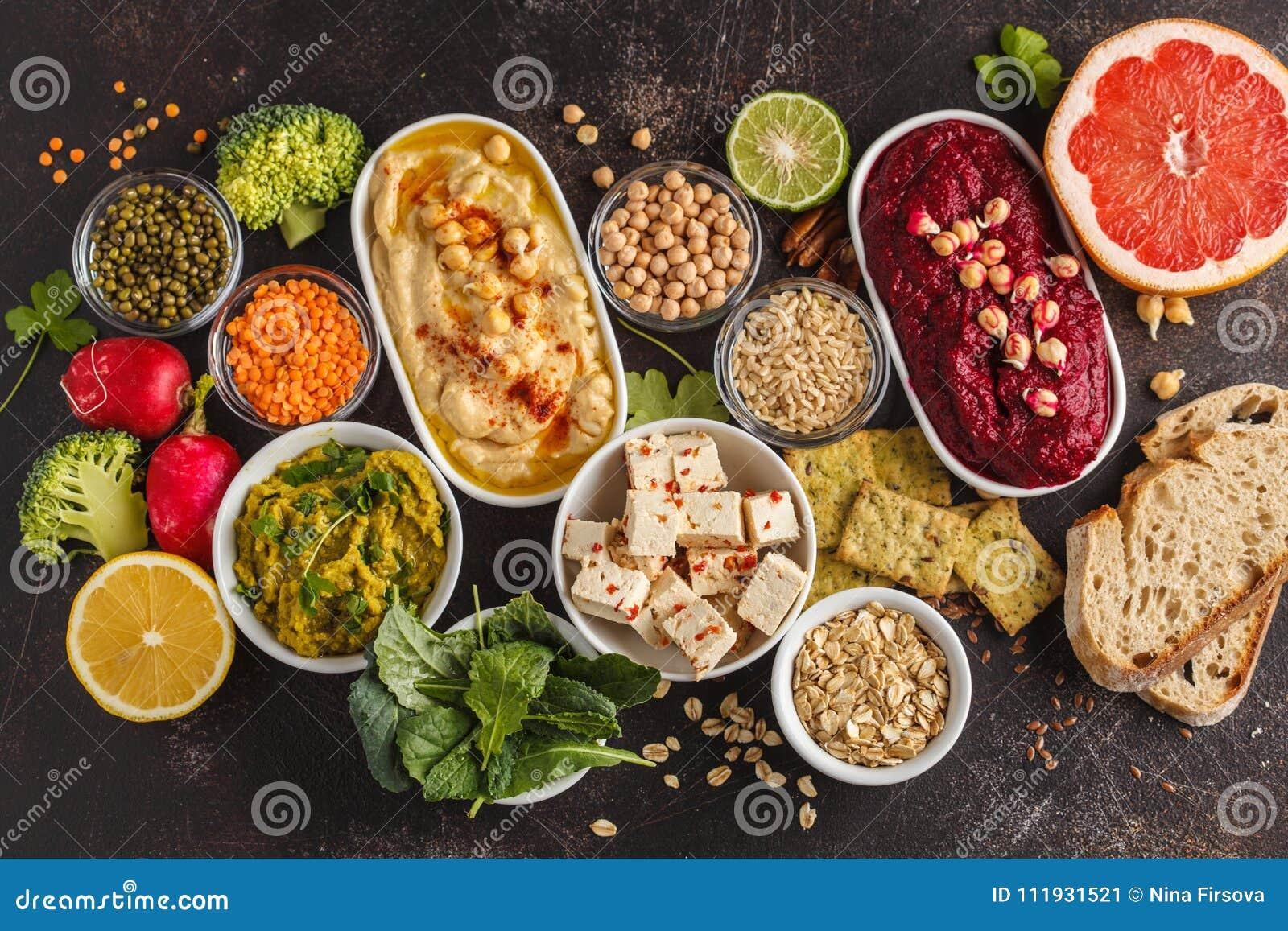 Fundo do alimento do vegetariano Petiscos do vegetariano: hummus, hummu das beterrabas