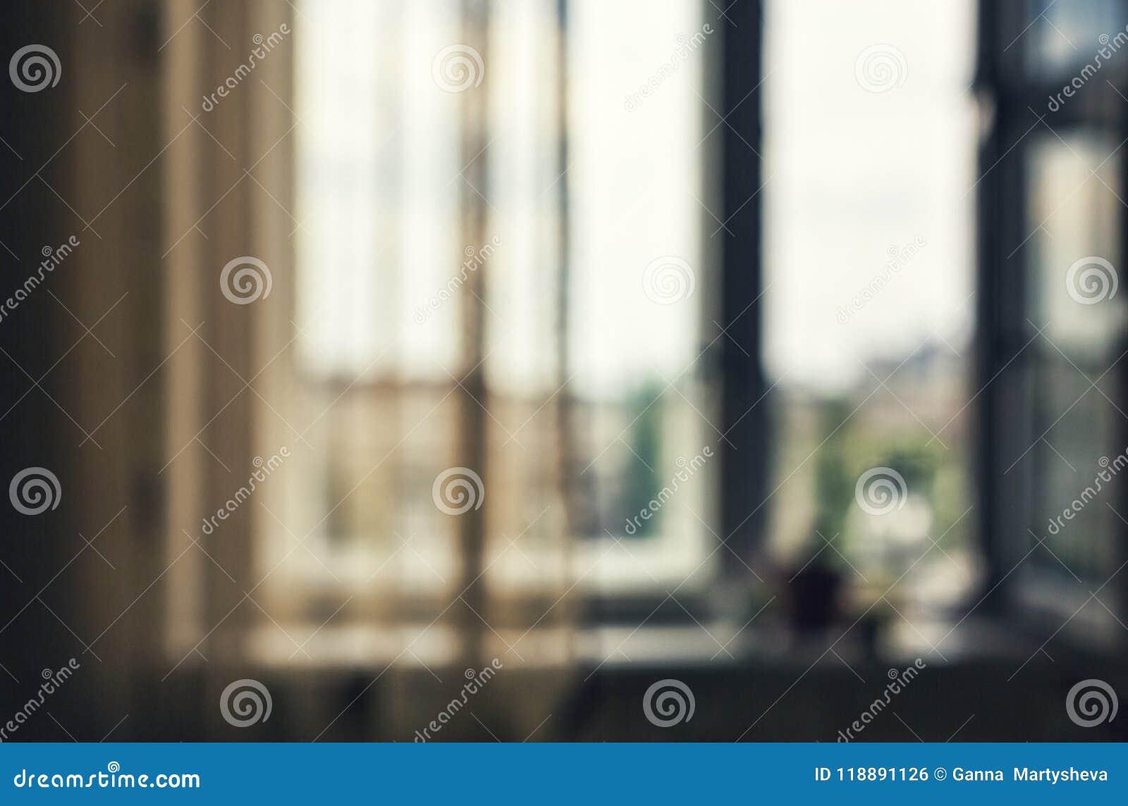 Fundo do borrão sala, uma janela Vista da cidade escritório, fundo da opinião da cidade