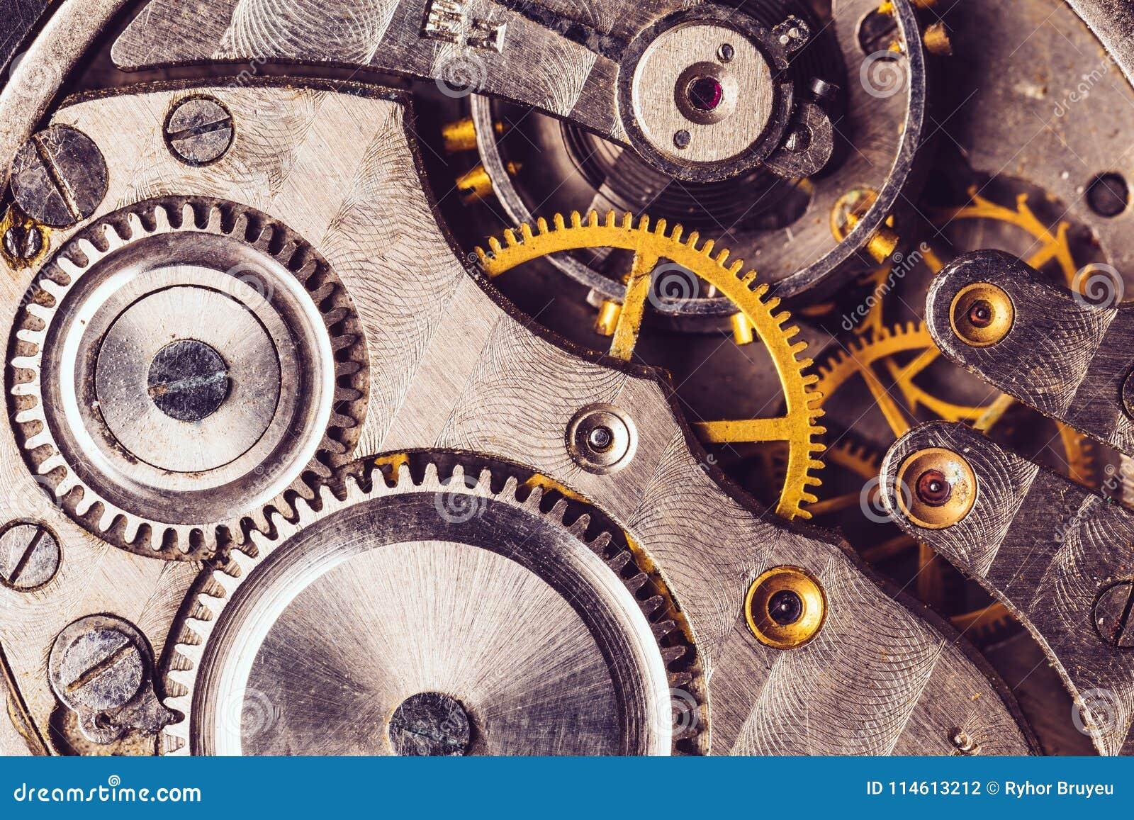 Fundo do maquinismo de relojoaria Mecanismo velho do relógio de pulso de disparo Maquinismo de relojoaria retro
