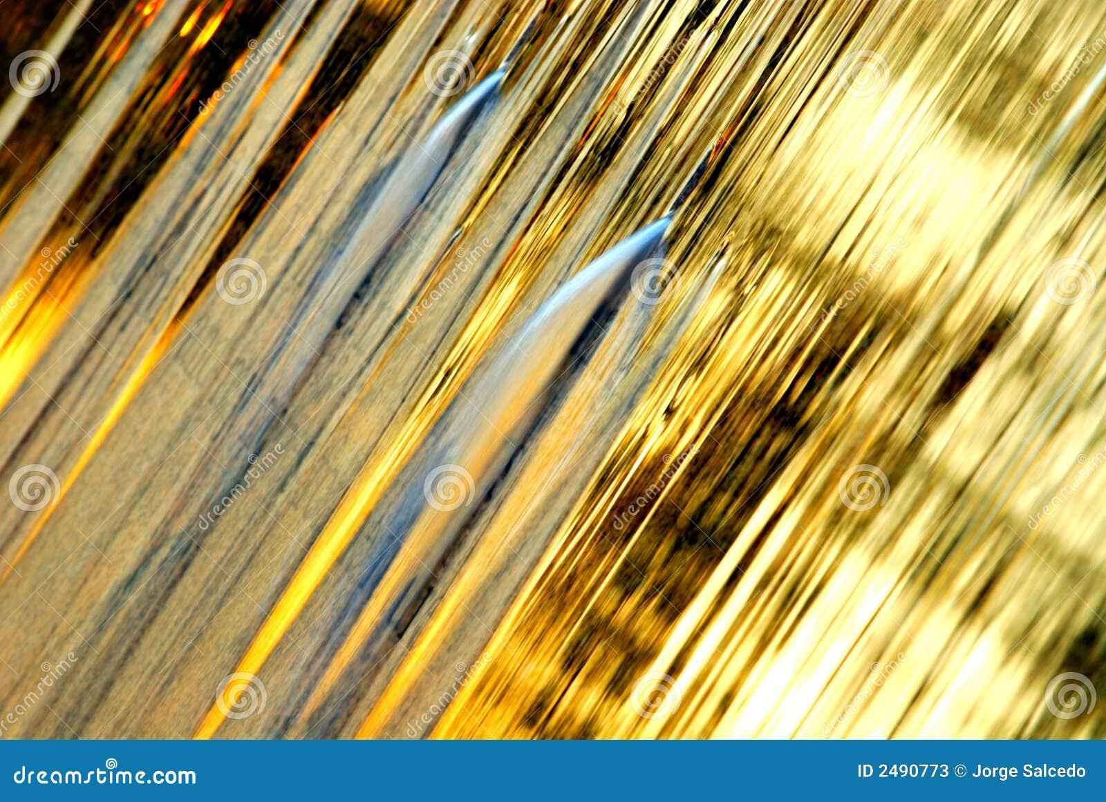 Fundo dourado do volume de água