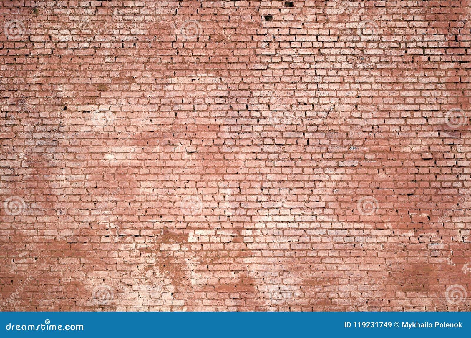 Fundo e textura quadrados da parede do bloco do tijolo Pintado no vermelho