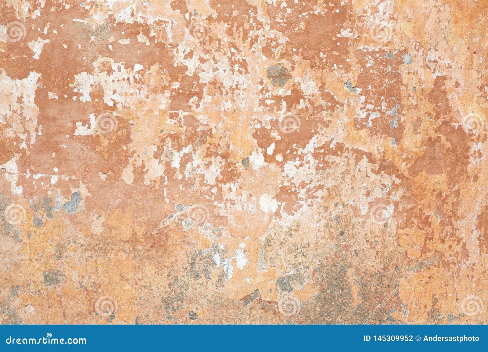 Fundo lascado bege velho da textura da parede em Itália