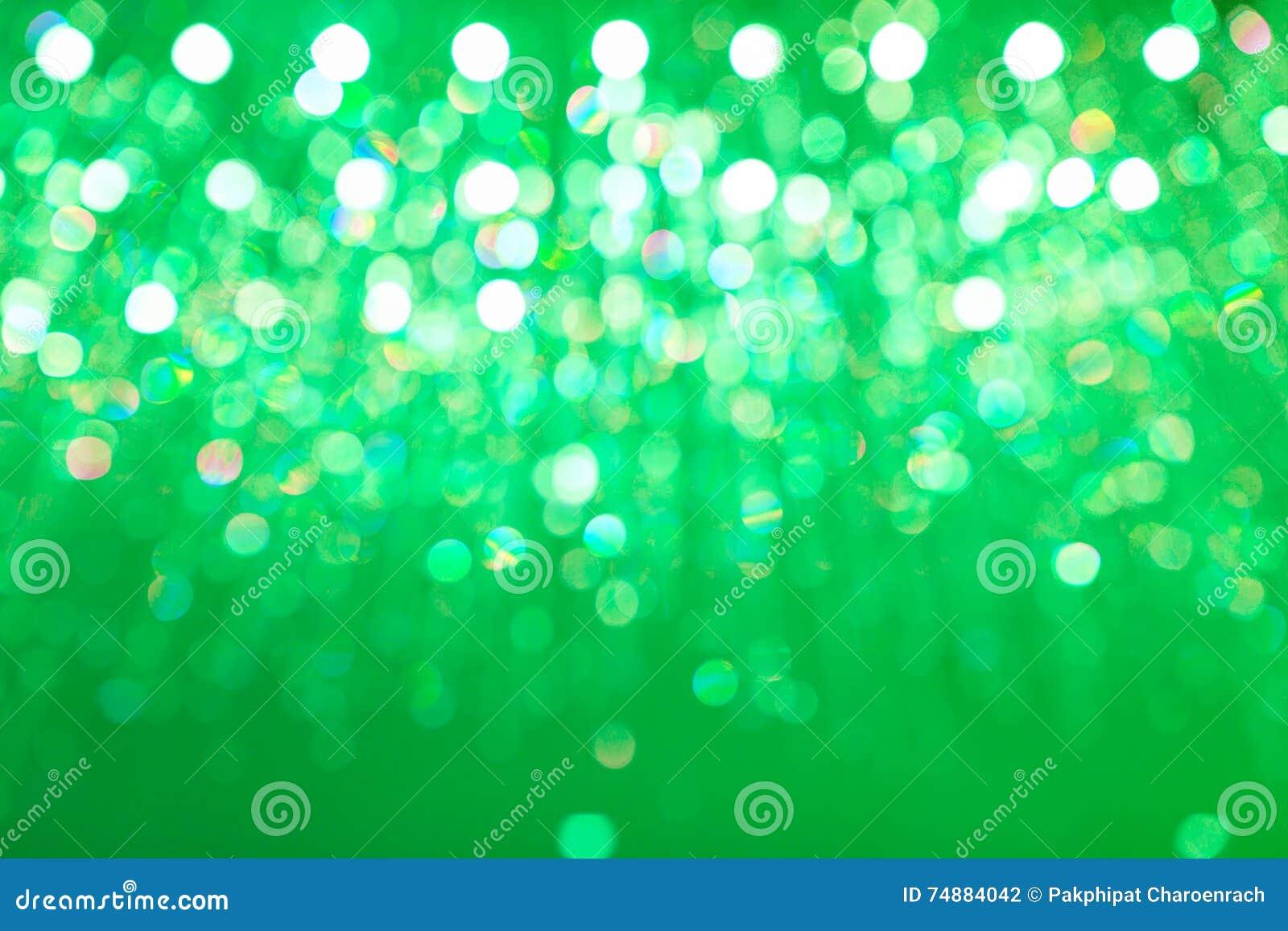 Fundo verde circular claro abstrato do bokeh