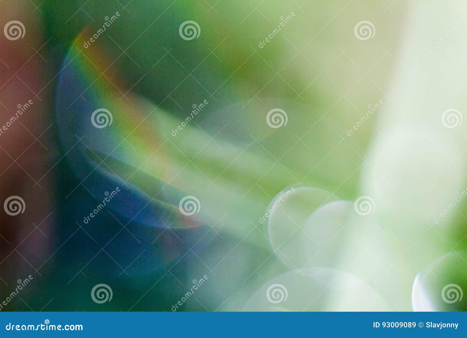 Fundo verde com pontos brilhantes blurry