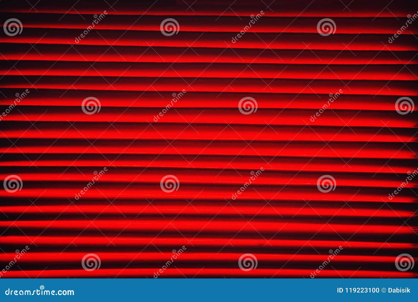 Fundo vermelho abstrato com o close up horizontal das listras
