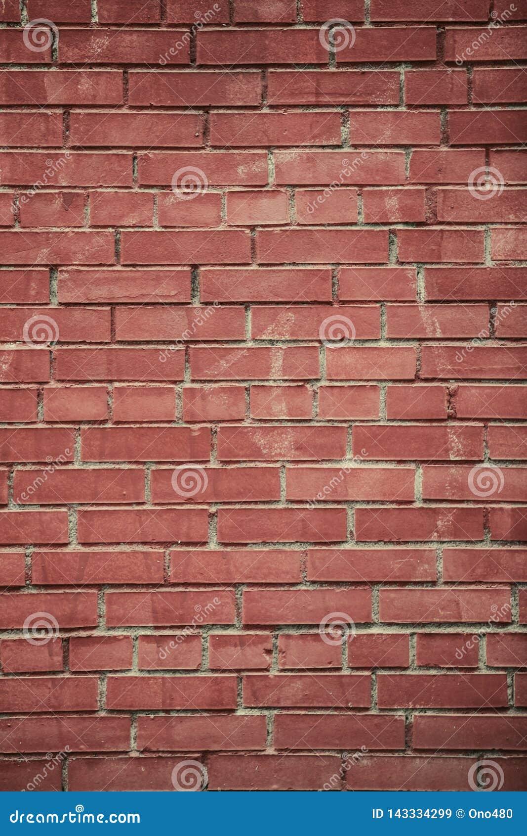 Fundos verticais da parede de tijolo vermelho