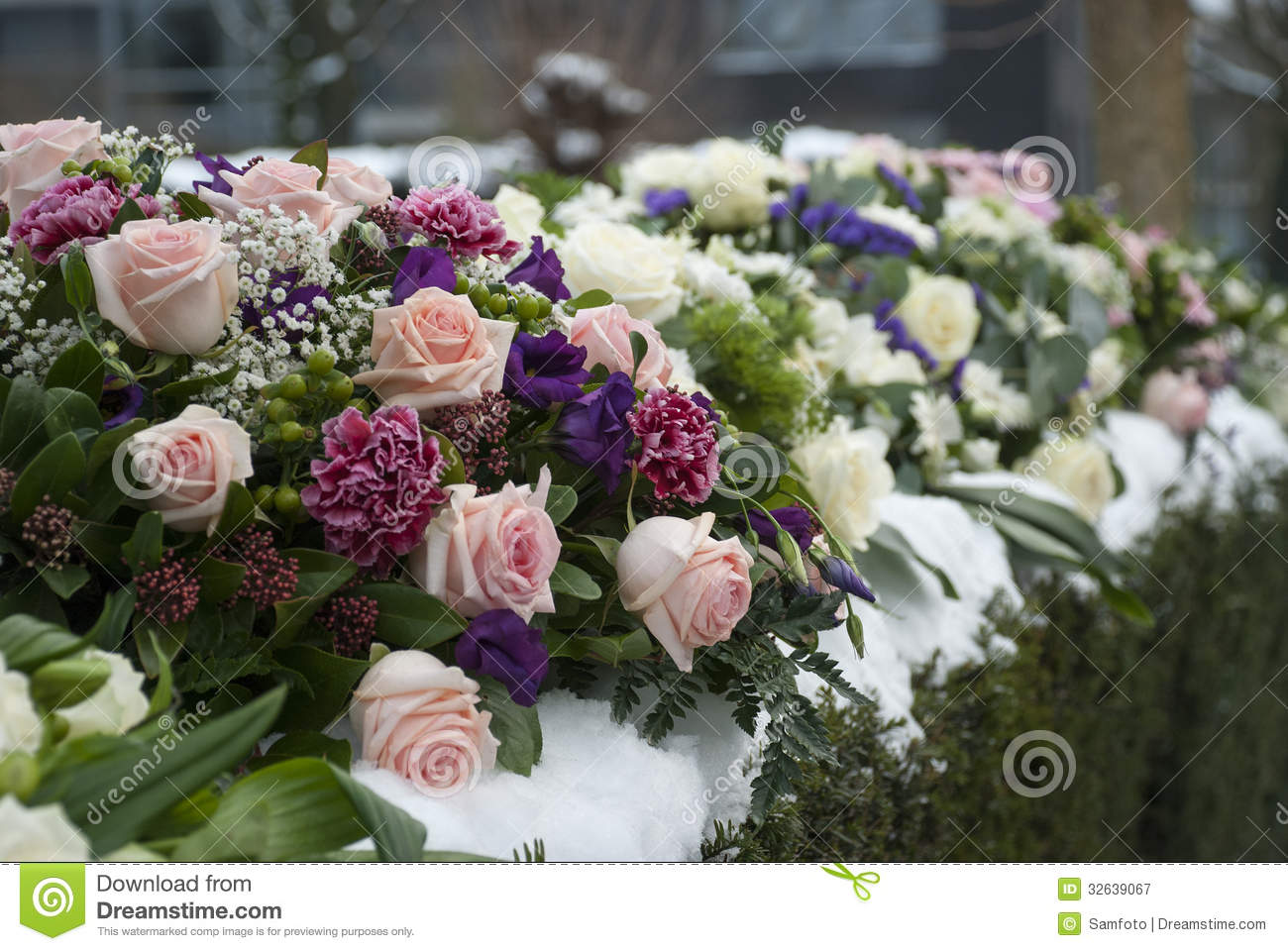 Funeral flowers arrangement in the snow on a cemetery stock image funeral flowers arrangement in the snow on a cemetery izmirmasajfo Image collections