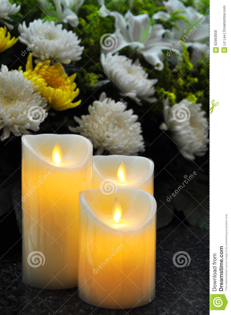 Funeral Flowers And Candles Stock Photo - Image: 62963656
