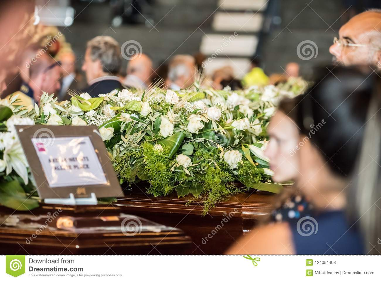 Funeral held for the victims of the morandi bridge genoa editorial a catholic ceremony held in the city of genova italy the funeral of the victims fallen during the collapse of the morandi bridge crowd of people with izmirmasajfo
