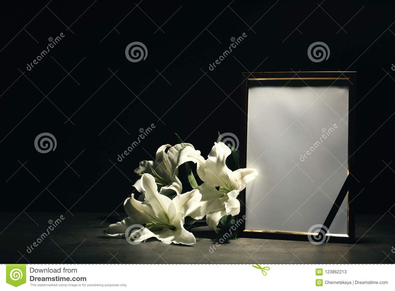 Funeral photo frame and lily flowers