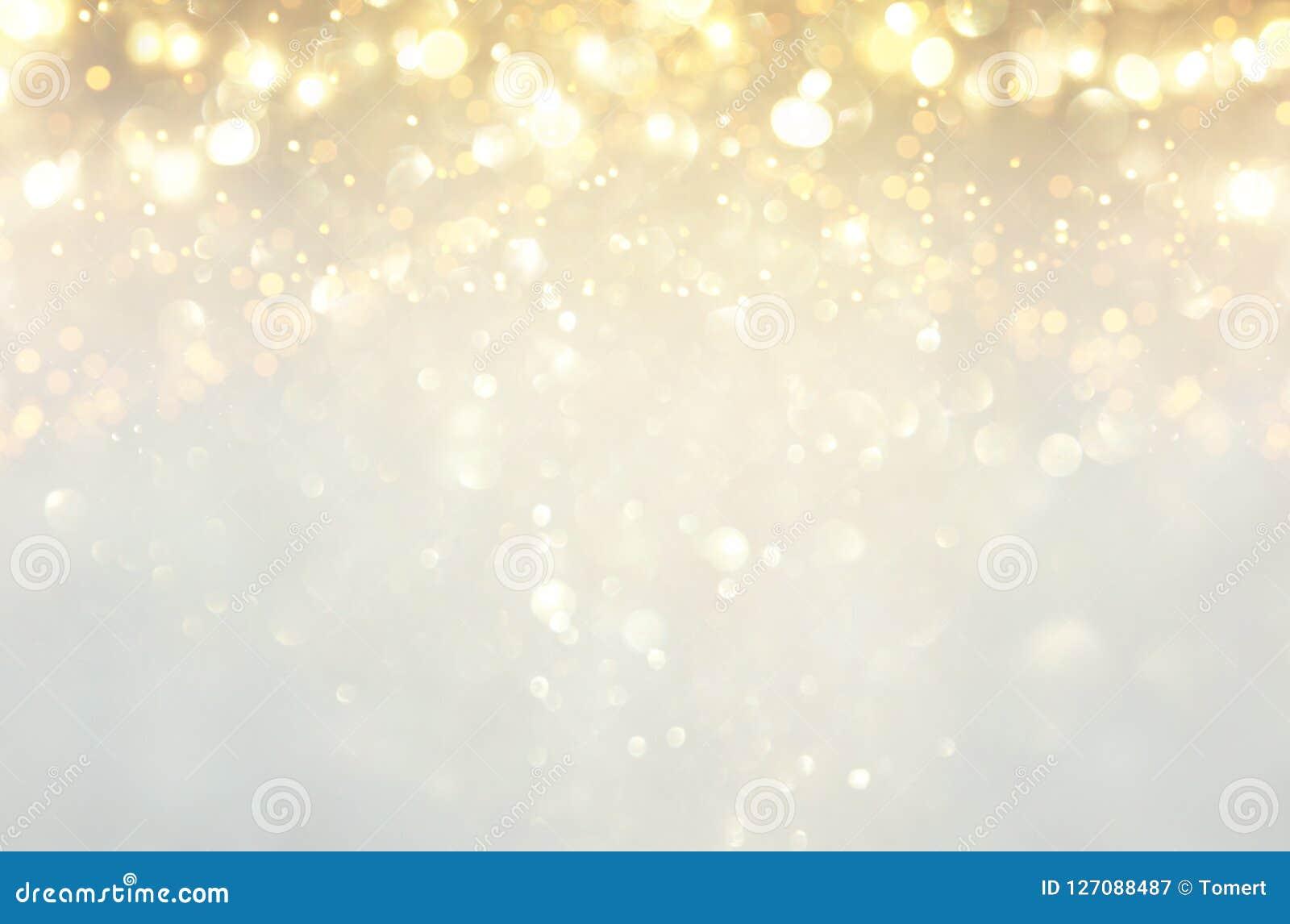 Funkelnweinlese beleuchtet Hintergrund Silber, Gold und Weiß de-fokussiert
