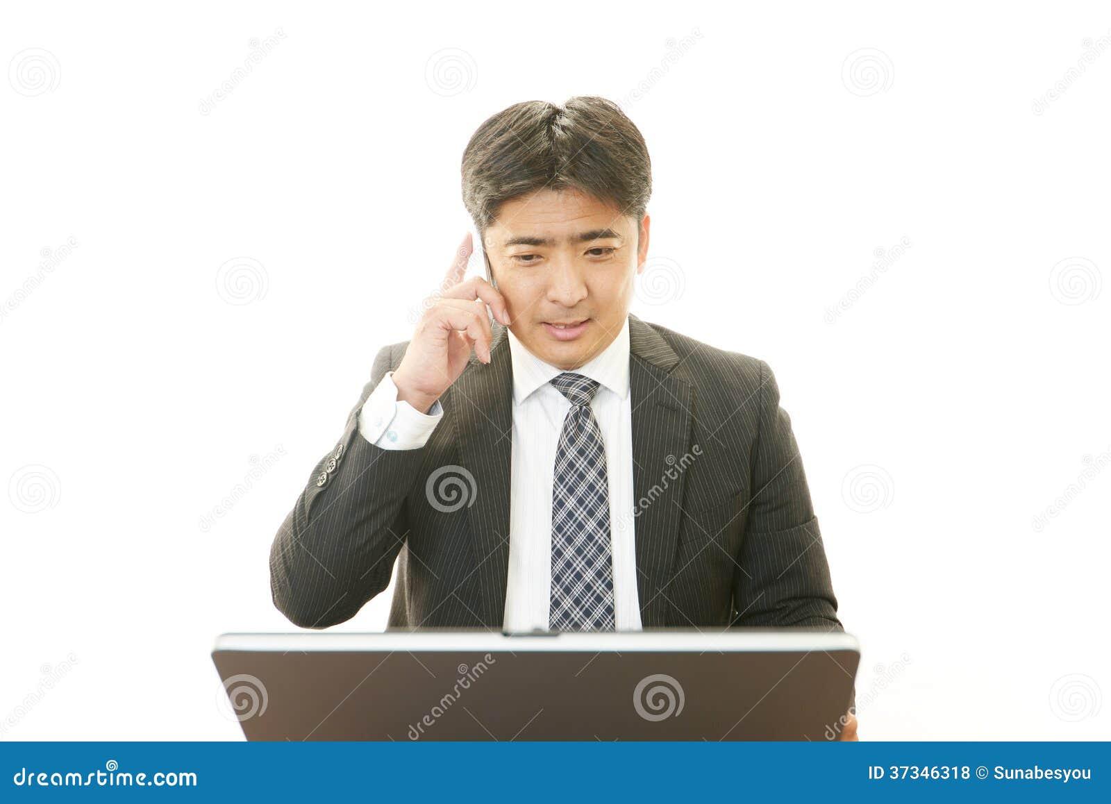 Funktionsduglig asiatisk affärsman