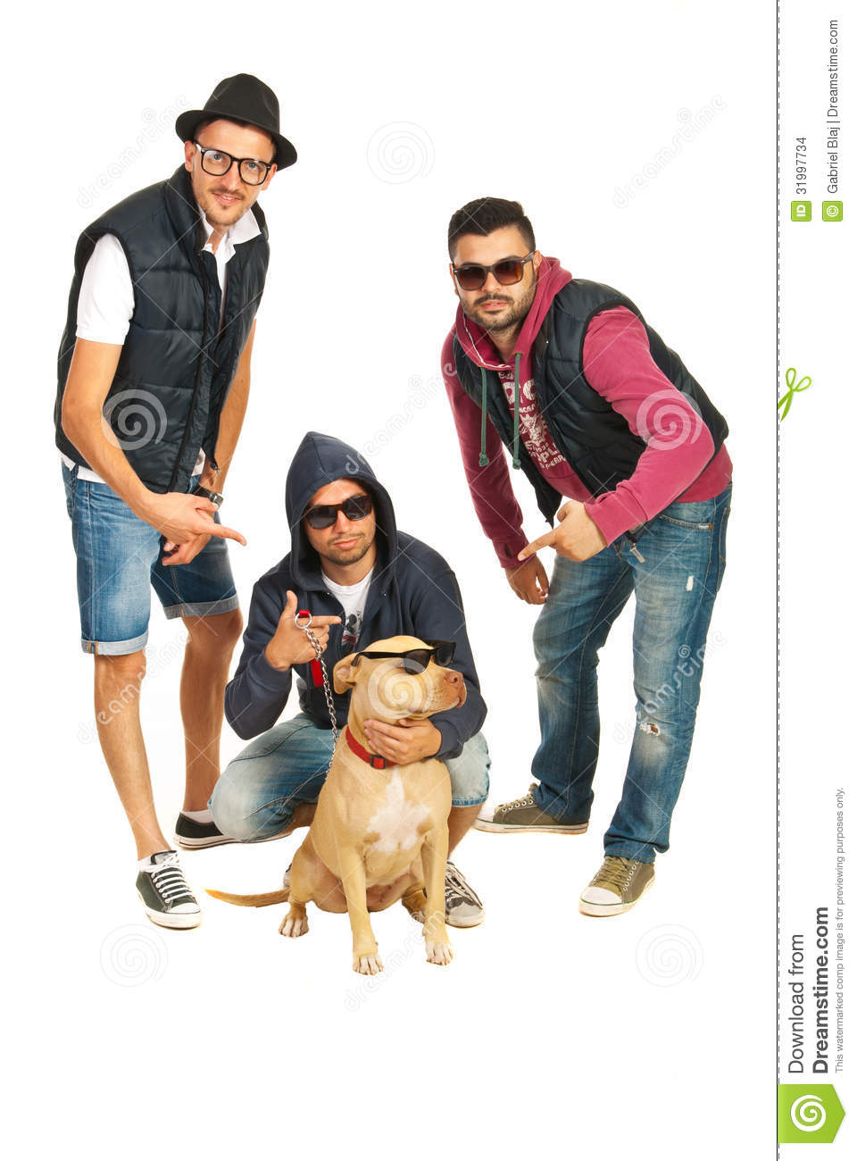 27e9fa0f2ee5 Funky group of three rappers pointing to their pitbull dog with sunglasses  isolated on white background