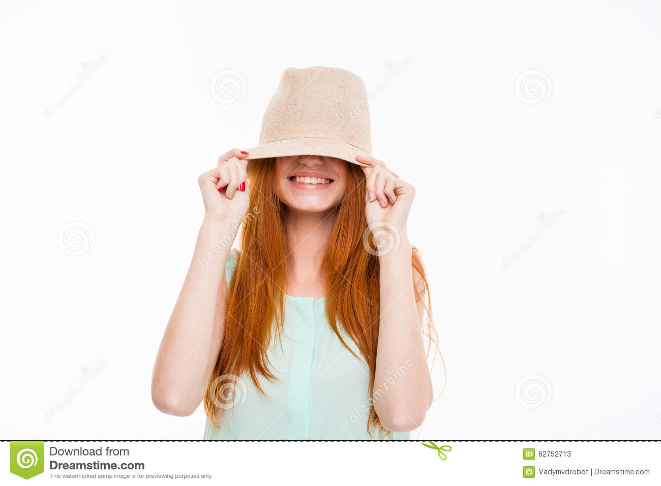Funny happy smiling amusing young woman with long red hair hiding eyes  under boonie hat posing on white background 78d457453d9
