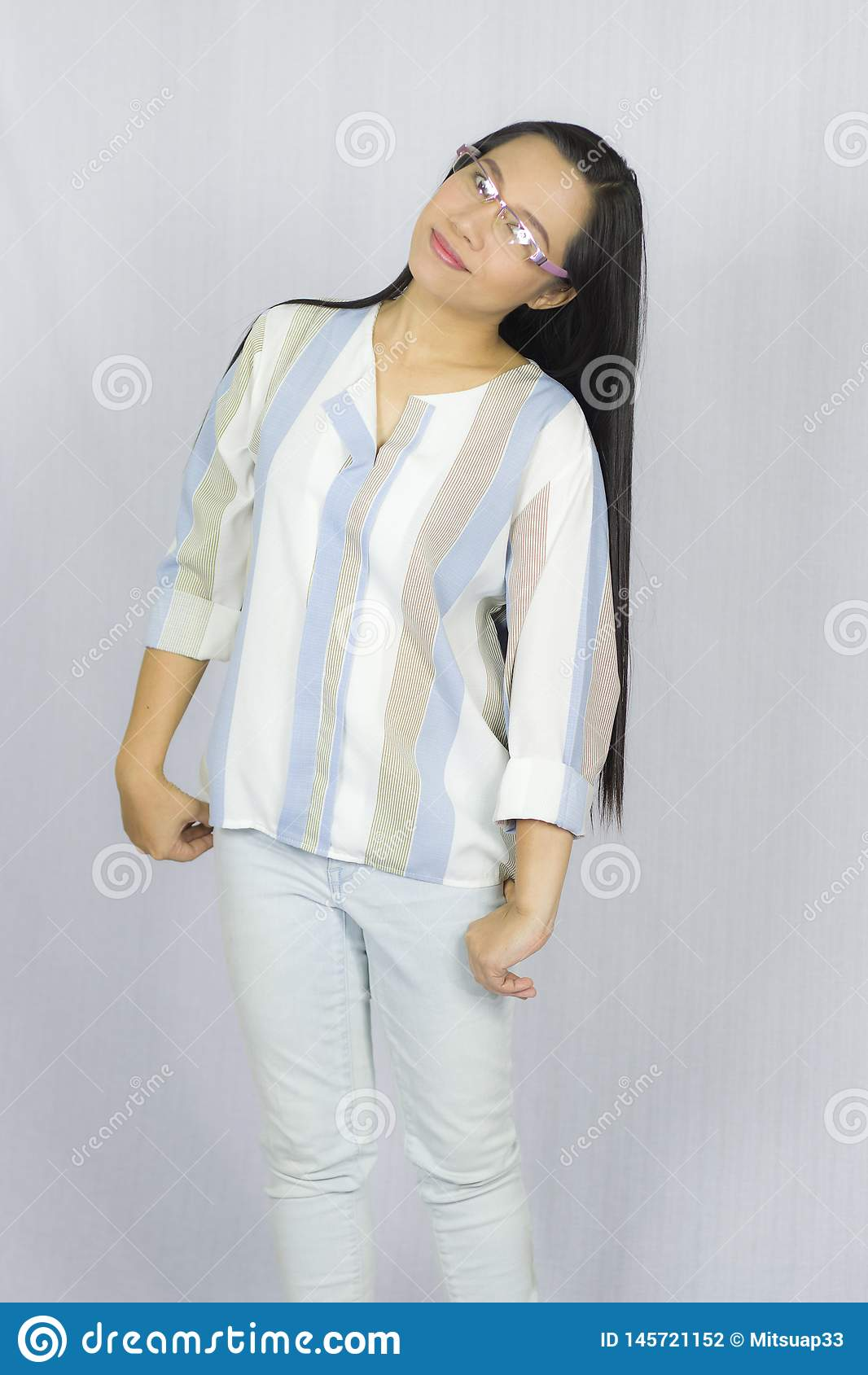 Funny Asian woman in glasses posing happy smile  Isolated on gray background