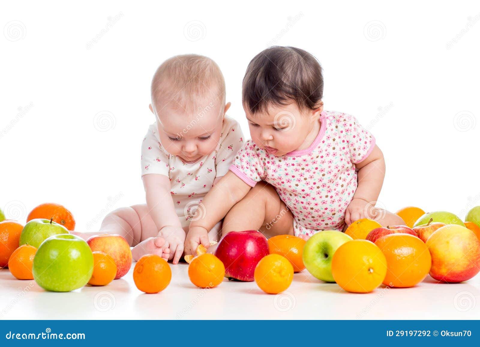 Funny babies eating healthy food fruits