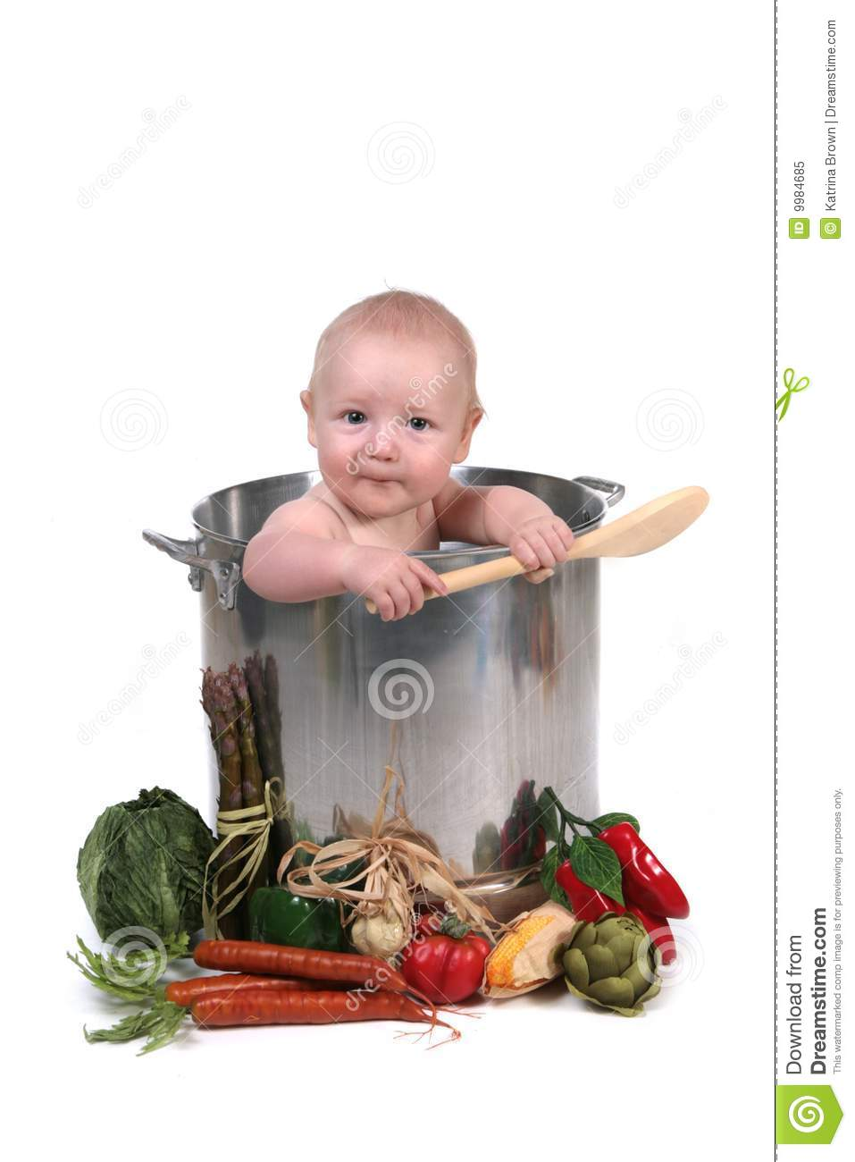 funny baby boy in a chef pot stock image
