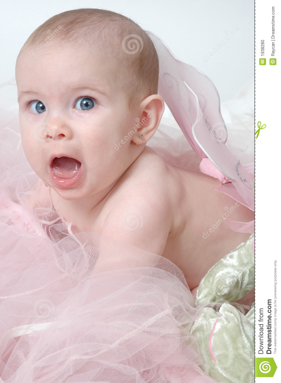baby with blue eyes wearing fairy wings or angel wings. Surprised baby