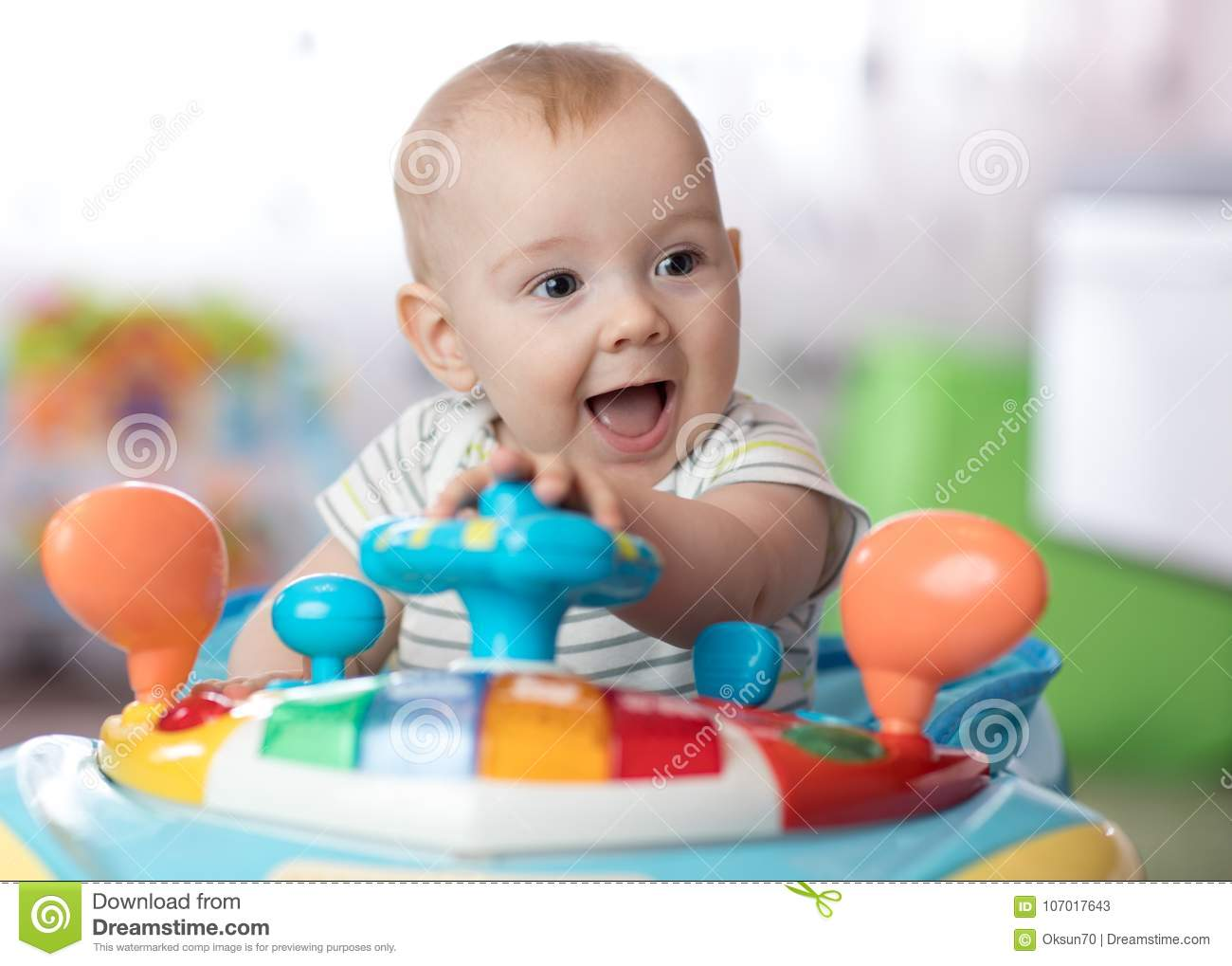 8c6b25a4c Funny Baby Playing In Baby Jumper Stock Image - Image of excited ...